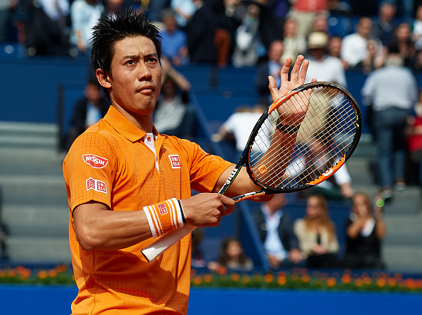 BARCELONA, SPAIN - APRIL 21:  Kei Nishikori of Japan celebrates after defeating Jeremy Chardy of France during day four of the Barcelona Open Banc Sabadell at the Real Club de Tenis Barcelona on April 21, 2016 in Barcelona, Spain.  (Photo by Manuel Queimadelos Alonso/Getty Images)