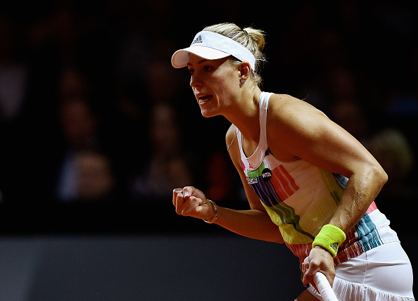STUTTGART, GERMANY - APRIL 23:  Angelique Kerber of Germany plays a backhand in her semi final match against Petra Kvitova of Czech Republic during Day 6 of the Porsche Tennis Grand Prix at Porsche-Arena on April 23, 2016 in Stuttgart, Germany.  (Photo by Dennis Grombkowski/Bongarts/Getty Images)