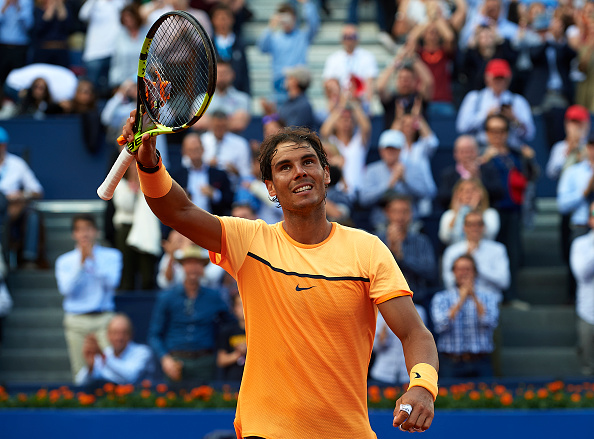 BARCELONA, SPAIN - APRIL 23:  Rafael Nadal of Spain celebrates defeating Philipp Kohlschreiber of Germany during day six of the Barcelona Open Banc Sabadell at the Real Club de Tenis Barcelona on April 23, 2016 in Barcelona, Spain.  (Photo by Manuel Queimadelos Alonso/Getty Images)