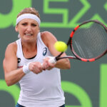 Switzerland's Timea Bacsinszky returns a shot against Romania's Simona Halep during the quarterfinals of the Miami Open at Crandon Park Tennis Center in Key Biscayne, Fla., on Tuesday, March 29, 2016. Bacsinszky advanced, 4-6, 6-3, 6-2. (Pedro Portal/El Nuevo Herald/TNS via Getty Images)