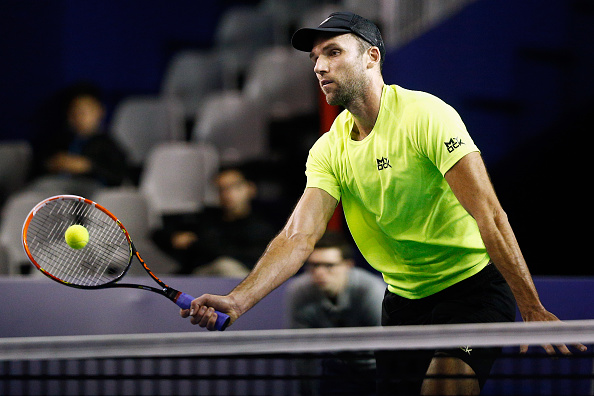 PARIS, FRANCE - NOVEMBER 03:  Ivo Karlovic of Croatia in action against Edouard Roger-Vasselin of France during Day 2 of the BNP Paribas Masters held at AccorHotels Arena on November 3, 2015 in Paris, France.  (Photo by Dean Mouhtaropoulos/Getty Images)