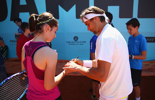 MADRID, SPAIN - APRIL 30:  David Ferrer of Spain signs autographs after a childrens tennis clinic during day one of the Mutua Madrid Open tennis tournament at the Caja Magica on April 30, 2016 in Madrid, Spain. .  (Photo by Clive Brunskill/Getty Images)