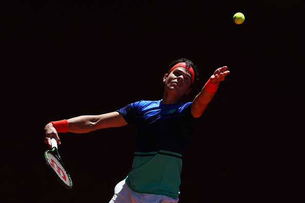 MADRID, SPAIN - MAY 02:  Milos Raonic of Canada in action against Thomaz Bellucci of Brazil during day three of the Mutua Madrid Open tennis tournament at the Caja Magica on May 02, 2016 in Madrid, Spain.  (Photo by Julian Finney/Getty Images)