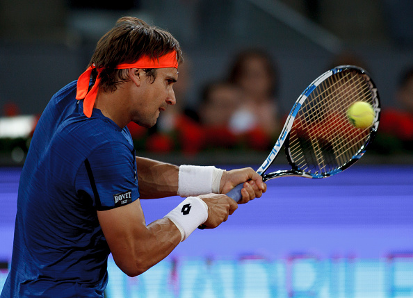 MADRID, SPAIN - May 2:David Ferrer of Spain returns the ball against Guillermo Garcia lopez of Spain during day four of the Mutua Madrid Open tennis tournament at the Caja Magica in Madrid on May 2, 2016.(Photo by Guillermo Martinez/Corbis via Getty Images)