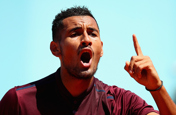 MADRID, SPAIN - MAY 03:  Nick Kyrgios of Australia shows his emotions against Guido Pella of Argentina in their first round match during day four of the Mutua Madrid Open tennis tournament at the Caja Magica on May 03, 2016 in Madrid,Spain.  (Photo by Clive Brunskill/Getty Images)