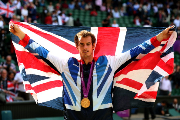 LONDON, ENGLAND - AUGUST 05:  Gold medalist Andy Murray of Great Britain celebrates during the medal ceremony for the Men's Singles Tennis match on Day 9 of the London 2012 Olympic Games at the All England Lawn Tennis and Croquet Club on August 5, 2012 in London, England. Murray defeated Federer in the gold medal match in straight sets 2-6, 1-6, 4-6.  (Photo by Clive Brunskill/Getty Images)