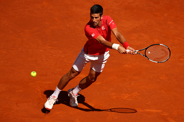 MADRID, SPAIN - MAY 04:  Novak Djokovic of Serbia plays a backhand against Borna Coric of Croatia in their second round match during day five of the Mutua Madrid Open tennis tournament at the Caja Magica on May 04, 2016 in Madrid.  (Photo by Clive Brunskill/Getty Images)