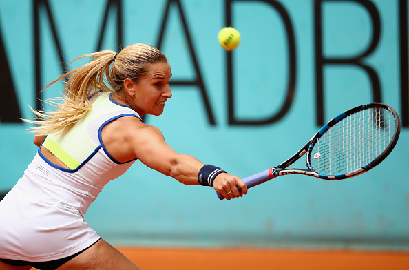 MADRID, SPAIN - MAY 05:  Dominika Cibulkova of Slovakia plays a backhand against Sorana Cirstea of Romania in their quarter final match match during day six of the Mutua Madrid Open tennis tournament at the Caja Magica  on May 05, 2016 in Madrid,Spain  (Photo by Clive Brunskill/Getty Images)