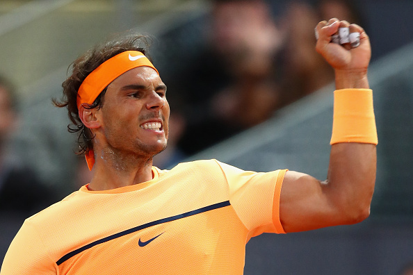 MADRID, SPAIN - MAY 05:  Rafael Nadal of Spain celebrates winning a game against Sam Querrey of USA during day six of the Mutua Madrid Open tennis tournament at the Caja Magica on May 05, 2016 in Madrid, Spain.  (Photo by Julian Finney/Getty Images)
