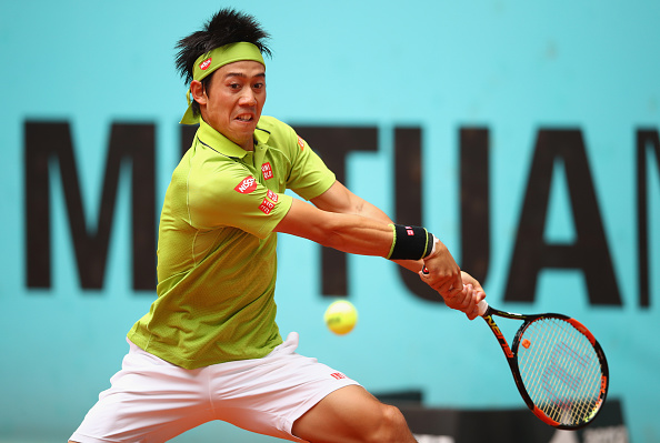 MADRID, SPAIN - MAY 05:  Kei Nishikori of Japan in action against Richard Gasquet of France in their third round match during day six of the Mutua Madrid Open tennis tournament at the Caja Magica  on May 05, 2016 in Madrid,Spain  (Photo by Clive Brunskill/Getty Images)