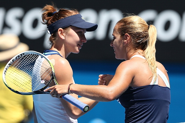 MELBOURNE, AUSTRALIA - JANUARY 22:  Dominika Cibulkova of Slovakia shakes hands with Simona Halep of Romania after Cibulkova won their quarterfinal match during day 10 of the 2014 Australian Open at Melbourne Park on January 22, 2014 in Melbourne, Australia.  (Photo by Clive Brunskill/Getty Images)