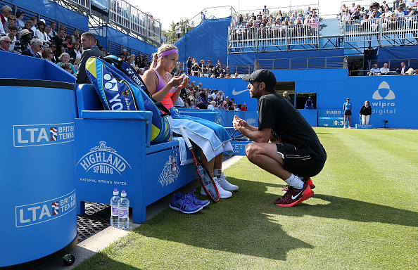 BIRMINGHAM, ENGLAND - JUNE 19:  Sabine Lisicki of Germany speaks to her coach Christopher Kas in her quarter final match over Daniela Hantuchova of Slovakia on day five of the Aegon Classic at Edgbaston Priory Club on June 19, 2015 in Birmingham, England.  (Photo by Jan Kruger/Getty Images for LTA)