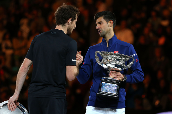MELBOURNE, AUSTRALIA - JANUARY 31:  Australian Open champion Novak Djokovic of Serbia shakes hands with Andy Murray of Great Britain during the trophy presentation after the Men's Singles Final during day 14 of the 2016 Australian Open at Melbourne Park on January 31, 2016 in Melbourne, Australia.  (Photo by Michael Dodge/Getty Images)