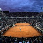 Roger Federer of Switzerland serves under the Rome lights during his semi-final match in Rome.