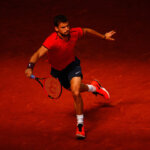 MADRID, SPAIN - MAY 03:  Grigor Dimitrov of Bulgaria in action against Pablo Carreno Busta of Spain during day four of the Mutua Madrid Open tennis tournament at the Caja Magica on May 03, 2016 in Madrid, Spain.  (Photo by Julian Finney/Getty Images)