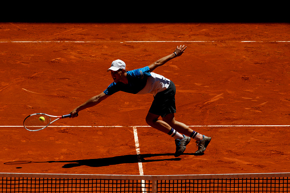 MADRID, SPAIN - MAY 3:Dominic Thiem of Austria returns the ball against Juan Martin Del Potro of Argentina during day five of the Mutua Madrid Open tennis tournament at the Caja Magica in Madrid on May 3, 2016.(Photo by Guillermo Martinez/Corbis via Getty Images)