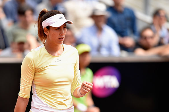 ROME, ITALY - MAY 12:  Garbine Muguruza of Spain celebrates a point in her match against Jelena Ostapenko of Latvia on Day Five of The Internazionali BNL d'Italia on May 12, 2016 in Rome, Italy.  (Photo by Dennis Grombkowski/Getty Images)