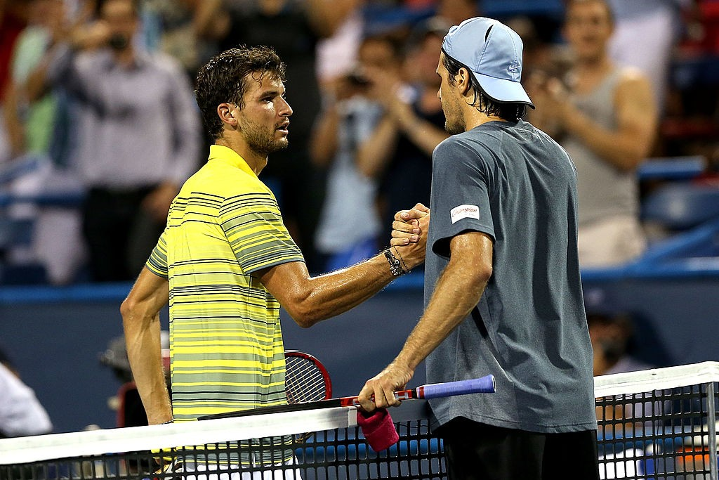 WASHINGTON, DC - AUGUST 02:  Grigor Dimitrov of Bulgaria congratulates Tommy Haas of Germany after their match during the Citi Open at the William H.G. FitzGerald Tennis Center on August 2, 2013 in Washington, DC.  (Photo by Matthew Stockman/Getty Images)