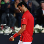 ROME, ITALY - MAY 14:  Novak Djokovic of Serbia looks on, after breaking a string on his racquet during his match against Kei Nishikori of Japan during day seven of The Internazionali BNL d'Italia 2016 on May 14, 2016 in Rome, Italy.  (Photo by Matthew Lewis/Getty Images)