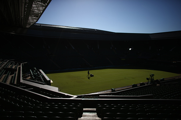 LONDON, ENGLAND - JUNE 30:  A member of the ground staff mows the grass on centre court on day two of Wimbledon tennis tournament on June 30, 2015 in London, England. The 129th tournament to be hosted at Wimbledon is due to run for two weeks from Monday 29th June.  (Photo by Carl Court/Getty Images)