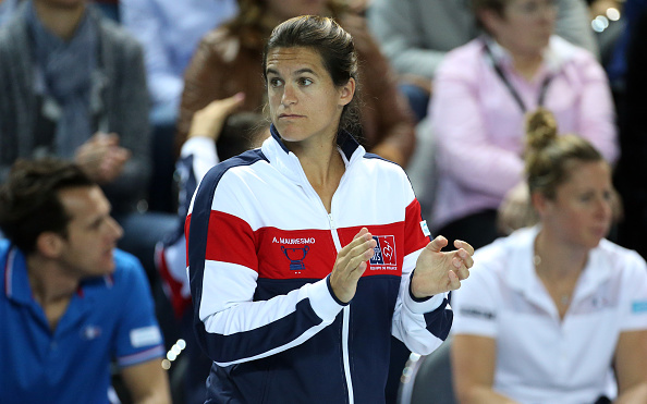 MARSEILLE, FRANCE - FEBRUARY 7: Captain of France Amelie Mauresmo reacts during day 2 of the Fed Cup World Group tie between France and Italy at Palais des Sports on February 7, 2016 in Marseille, France. (Photo by Jean Catuffe/Getty Images)