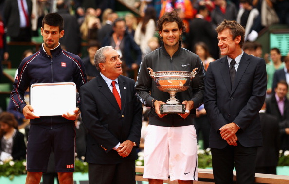PARIS, FRANCE - JUNE 11:  (L-R) Novak Djokovic of Serbia, President of the French Tennis Federation Jean Gachassin, Rafael Nadal of Spain and Mats Wilander pose after the men's singles final during day 16 of the French Open at Roland Garros on June 11, 2012 in Paris, France.  (Photo by Clive Brunskill/Getty Images)