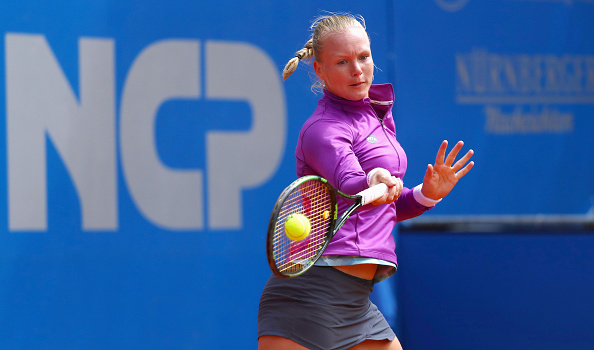 NUREMBERG, GERMANY - MAY 18:  Kiki Bertens of Netherlands returns the ball to Roberta Vinci of Italy during day five of the Nuernberger Versicherungscup 2016 on May 18, 2016 in Nuremberg, Germany.  (Photo by Alex Grimm/Bongarts/Getty Images)