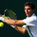 KEY BISCAYNE, FL - MARCH 26:  Federico Delbonis of Argentina in action against Grigor Dimitrov of Bulgaria in their second round match during the Miami Open Presented by Itau at Crandon Park Tennis Center on March 26, 2016 in Key Biscayne, Florida.  (Photo by Clive Brunskill/Getty Images)