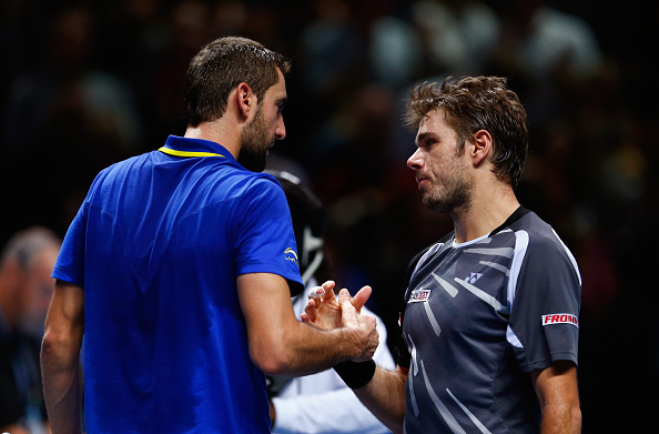 LONDON, ENGLAND - NOVEMBER 14:  Marin Cilic of Croatia shakes hands with Stan Wawrinka of Switzerland after the round robin singles match on day six of the Barclays ATP World Tour Finals at O2 Arena on November 14, 2014 in London, England.  (Photo by Julian Finney/Getty Images)