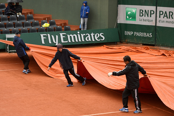 during the **** first round match against ***** on day one of the 2016 French Open at Roland Garros on May 22, 2016 in Paris, France.