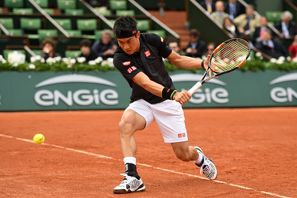 PARIS, FRANCE - MAY 23:  Kei Nishikori of Japan hits a backhand during the Men's Singles first round match against Simone Bolelli of Italy  on day two of the 2016 French Open at Roland Garros on May 23, 2016 in Paris, France.  (Photo by Dennis Grombkowski/Getty Images)