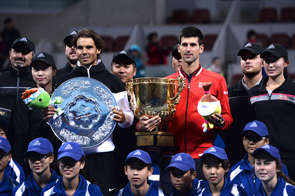 BEIJING, CHINA - OCTOBER 11:  (CHINA OUT) Rafael Nadal (L) of Spain holds the runner up trophy while Novak Djokovic of Serbia holds the winners trophy after the men's final on day 9 of the 2015 China Open at the China National Tennis Centre on October 11, 2015 in Beijing, China.  (Photo by VCG/VCG via Getty Images)