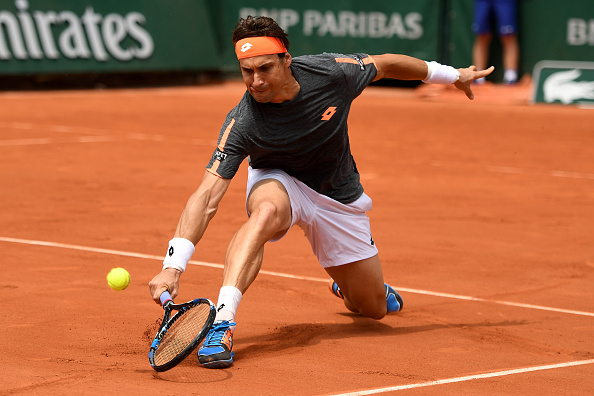 PARIS, FRANCE - MAY 28:  David Ferrer of Spain hits a backhand during the Men's Singles third round match against Feliciano Lopez of Spain on day seven of the 2016 French Open at Roland Garros on May 28, 2016 in Paris, France.  (Photo by Dennis Grombkowski/Getty Images)