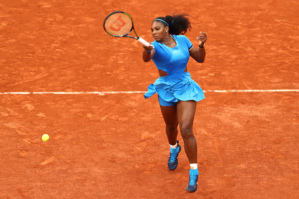 PARIS, FRANCE - MAY 26:  Serena Williams of the United States hits a forehand during the Ladies Singles second round match against Teliana Pereira of Brazil on day five of the 2016 French Open at Roland Garros on May 26, 2016 in Paris, France.  (Photo by Julian Finney/Getty Images)