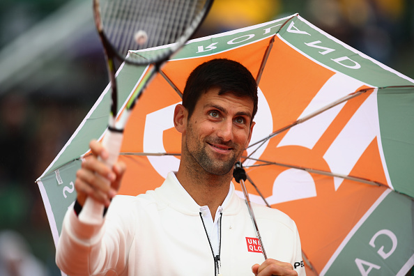 PARIS, FRANCE - MAY 31:  Novak Djokovic of Serbia walks back onto court following a rain delay during the Men's Singles fourth round match against Roberto Bautista Agut of Spain on day ten of the 2016 French Open at Roland Garros on May 31, 2016 in Paris, France.  (Photo by Clive Brunskill/Getty Images)