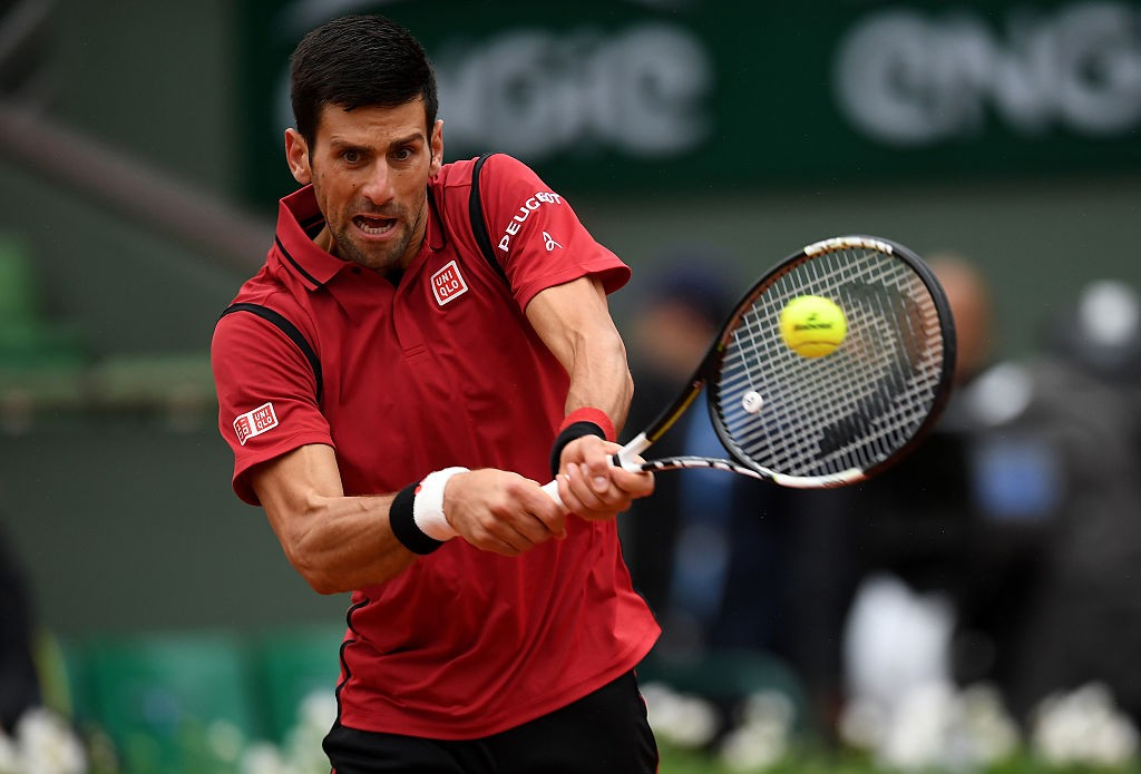 PARIS, FRANCE - JUNE 02:  Novak Djokovic of Serbia hits a backhand during the Men's Singles quarter final match against Tomas Berdych of Czech Republic on day twelve of the 2016 French Open at Roland Garros on June 2, 2016 in Paris, France.  (Photo by Dennis Grombkowski/Getty Images)