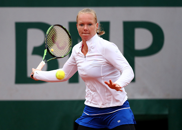 PARIS, FRANCE - JUNE 02:  Kiki Bertens of Netherlands hits a forehand during the Ladies Singles quarter final match against Timea Bacsinszky of Switzerland on day twelve of the 2016 French Open at Roland Garros on June 2, 2016 in Paris, France.  (Photo by Julian Finney/Getty Images)