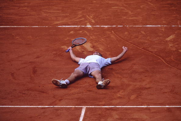 10 June 2001:  Gustavo Kuerten of Brazil celebrates after winning his third successive French Open at Roland Garros, in Paris, France.   Mandatory Credit: Clive Brunskill /Allsport