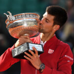PARIS, FRANCE - JUNE 05:  Champion Novak Djokovic of Serbia kisses the trophy following his victory during the Men's Singles final match against Andy Murray of Great Britain on day fifteen of the 2016 French Open at Roland Garros on June 5, 2016 in Paris, France.  (Photo by Dennis Grombkowski/Getty Images)