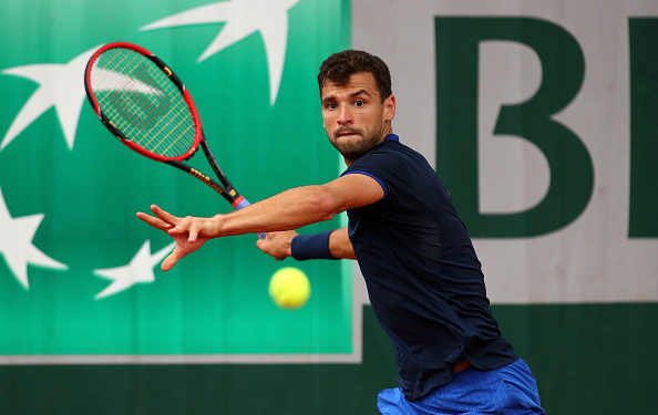 PARIS, FRANCE - MAY 23:  Grigor Dimitrov of Bulgaria lines up a forehand during the Men's Singles first round match against Viktor Troicki of Serbia on day two of the 2016 French Open at Roland Garros on May 23, 2016 in Paris, France.  (Photo by Clive Brunskill/Getty Images)
