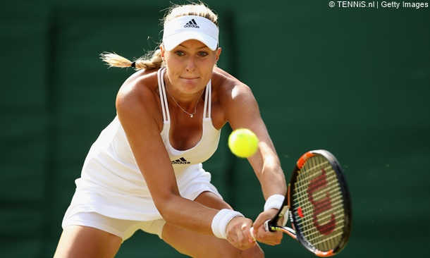LONDON, ENGLAND - JULY 03:  Kristina Mladenovic of France returns a shot in her Ladies' Singles Third Round match against Victoria Azarenka of Belarus during day five of the Wimbledon Lawn Tennis Championships at the All England Lawn Tennis and Croquet Club on July 3, 2015 in London, England.  (Photo by Ian Walton/Getty Images)