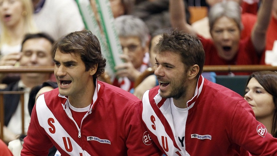 NOVI SAD, SERBIA - FEBRUARY 01: Roger Federer (L) and Stanislas Wawrinka (L) react during the men's doubles match of Marco Chiudinelli and Michael Lammer of Switzerland against Filip Krajinovic and Nenad Zimonjic of Serbia on day two of the Davis Cup match between Serbia and Switzerland on February 1, 2014 in Novi Sad, Serbia. (Photo by Srdjan Stevanovic/Getty Images)