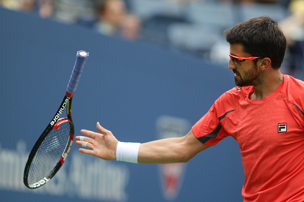 Janko Tipsarevic, Serbia, in a action against David Ferrer, Spain, during the US Open Tennis Tournament, Flushing, New York. USA. 6th September 2012. Photo Tim Clayton (Photo by Tim Clayton/Corbis via Getty Images)