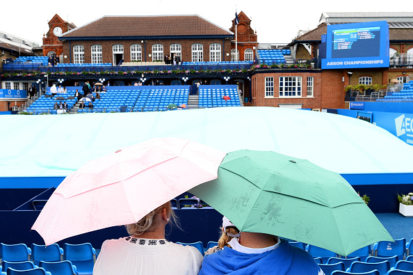LONDON, ENGLAND - JUNE 13: Spectators shelter under their umbrellas as it rains over Centre Court at Queens Club on June 13, 2016 in London, England. (Photo by Patrik Lundin/Getty Images)