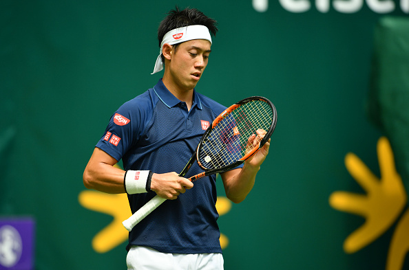 HALLE, GERMANY - JUNE 13:  Kei Nishikori of Japan looks on in his match against Lucas Pouille of France during day one of the Gerry Weber Open at Gerry Weber Stadium on June 13, 2016 in Halle, Germany.  (Photo by Thomas Starke/Bongarts/Getty Images)