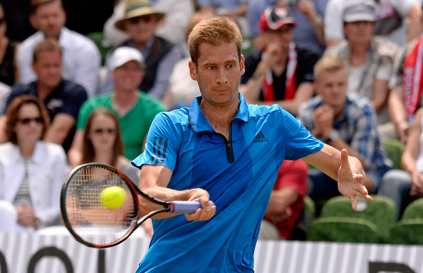STUTTGART, GERMANY - JUNE 10: Florian Mayer of Germany returns against Roger Federer of Switzerland during the quarterfinals on day 7 of Mercedes Cup 2016 on June 10, 2016 in Stuttgart, Germany. (Photo by Daniel Kopatsch/Bongarts/Getty Images)