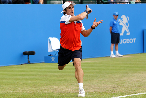 NOTTINGHAM, ENGLAND - JUNE 22:  Pablo Cuevas of Uruguay plays a forehand during his men's singles match against Daniel Evans of Great Britain during day three of the ATP Aegon Open Nottingham at Nottingham Tennis Centre on June 22, 2016 in Nottingham, England.  (Photo by Daniel Smith/Getty Images)