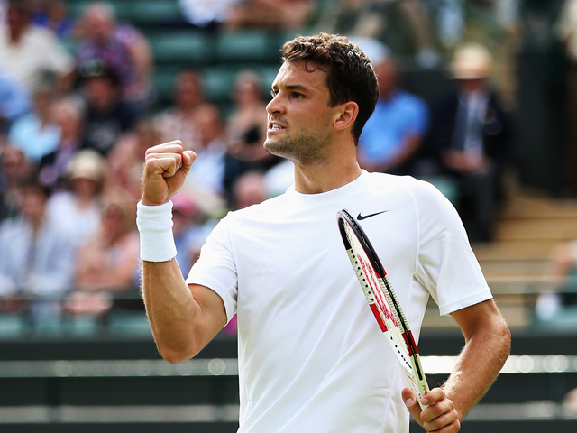 LONDON, ENGLAND - JUNE 23:  Grigor Dimitrov of Bulgaria celebrates a point during his Gentlemen's Singles first round match against Ryan Harrison of the United States of Austria on day one of the Wimbledon Lawn Tennis Championships at the All England Lawn Tennis and Croquet Club at Wimbledon on June 23, 2014 in London, England.  (Photo by Steve Bardens/Getty Images)