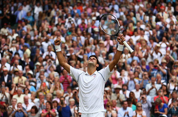 LONDON, ENGLAND - JULY 12:  Novak Djokovic of Serbia celebrates his victory after winning the Final Of The Gentlemen's Singles against Roger Federer of Switzerland on day thirteen of the Wimbledon Lawn Tennis Championships at the All England Lawn Tennis and Croquet Club on July 12, 2015 in London, England.  (Photo by Clive Brunskill/Getty Images)