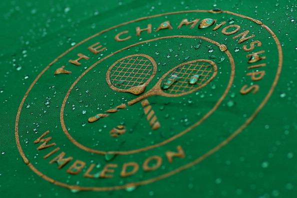 LONDON, ENGLAND - JUNE 28:  Raindrops are seen on the Wimbledon logo on day six of the Wimbledon Lawn Tennis Championships at the All England Lawn Tennis and Croquet Club at Wimbledon on June 28, 2014 in London, England.  (Photo by Steve Bardens/Getty Images)